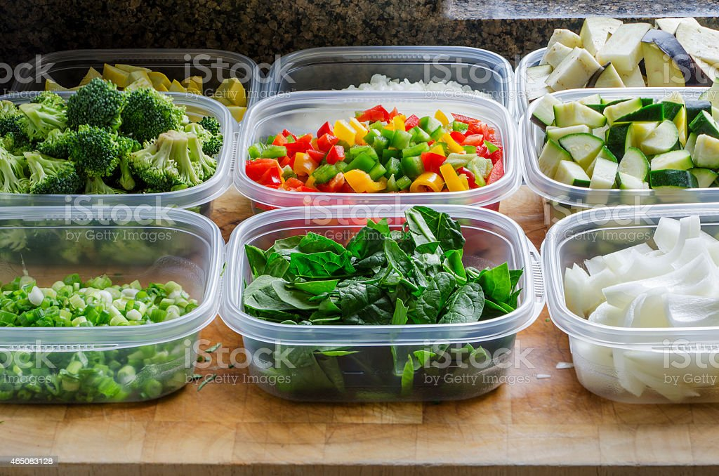 chopped vegetables in plastic containers stock photo
