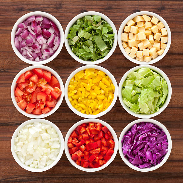 Chopped vegetables Nine bowls containing variety of chopped vegetables chopped food stock pictures, royalty-free photos & images
