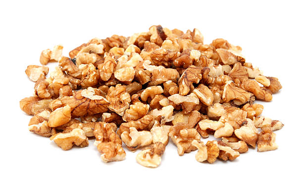 Chopped walnuts Chopped walnuts, isolated on a white background walnut stock pictures, royalty-free photos & images