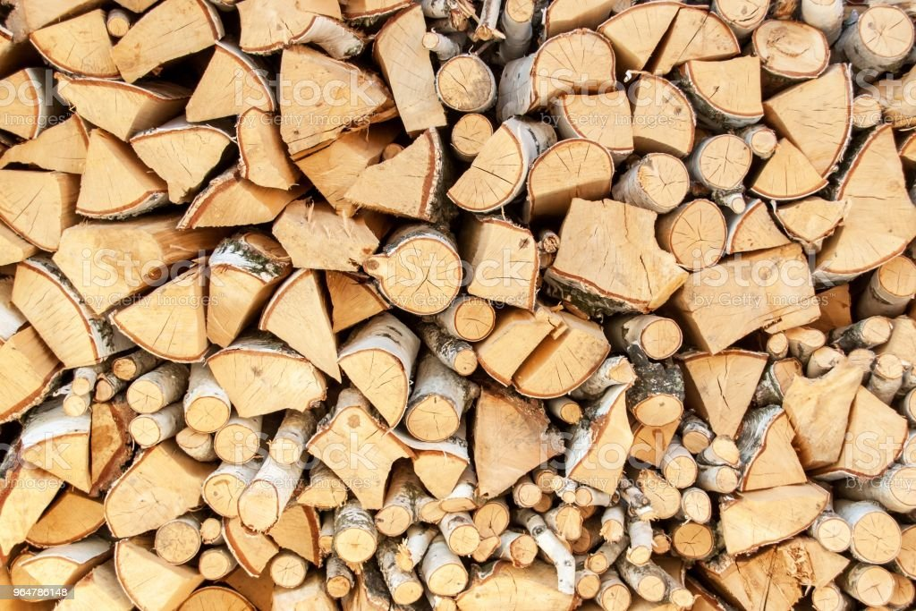 Chopped wood of birch. Wood preparation for heating. Ecological heating of the house. royalty-free stock photo