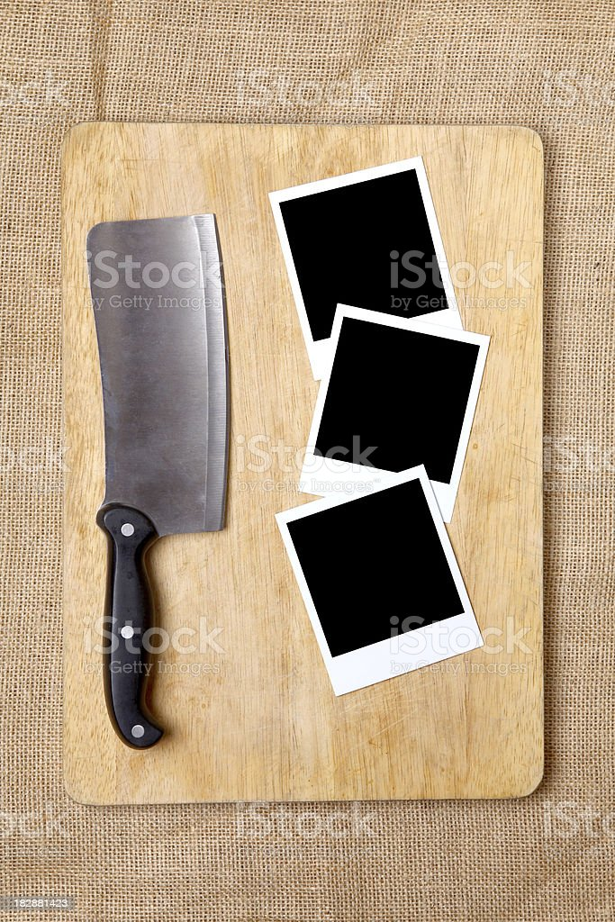 Chopping board and Butchers knife stock photo