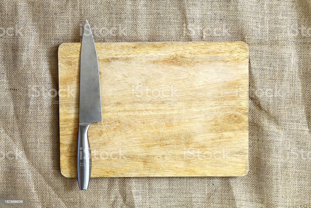 Chopping board and knife stock photo