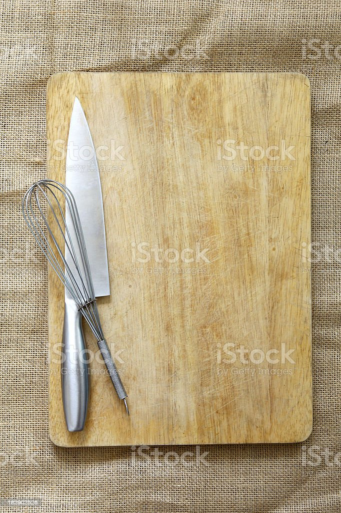 Chopping board and Utensils stock photo
