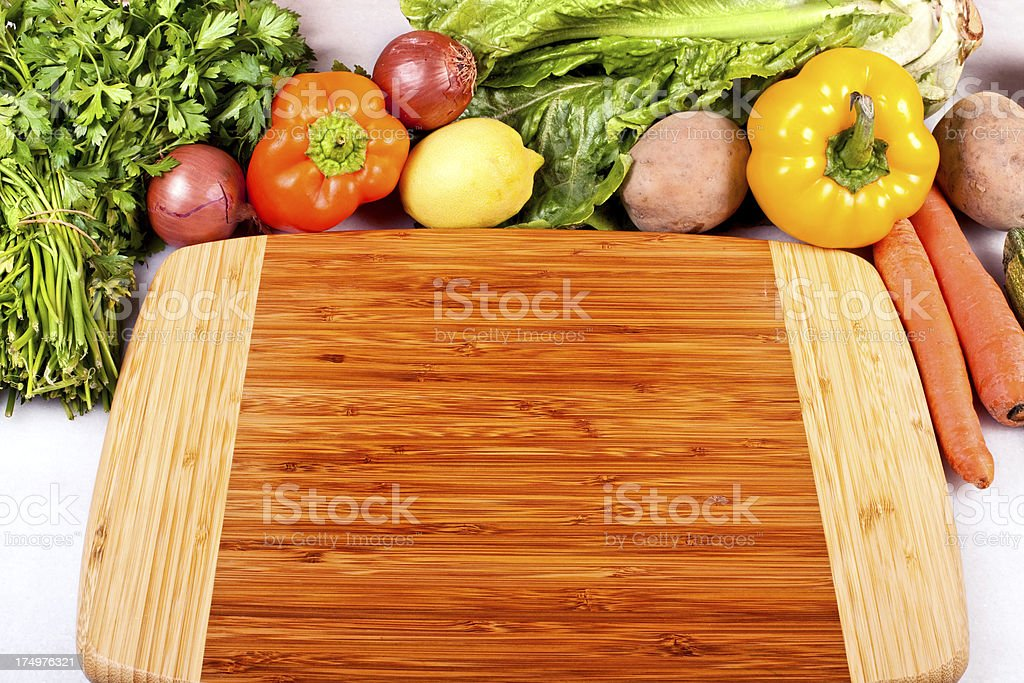 Chopping board and vegetables royalty-free stock photo