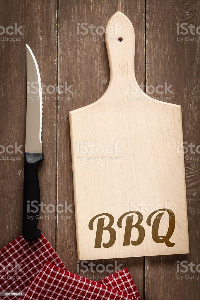Chopping board, kitchen towel and knife, Barbecue, invitation stock photo