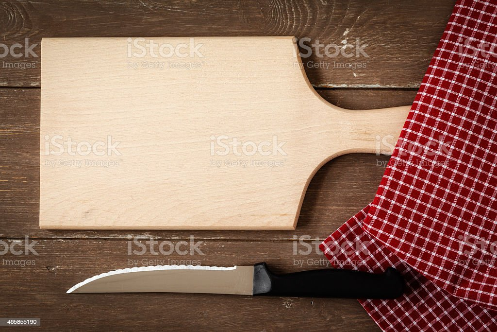 Chopping board, kitchen towel and knife stock photo