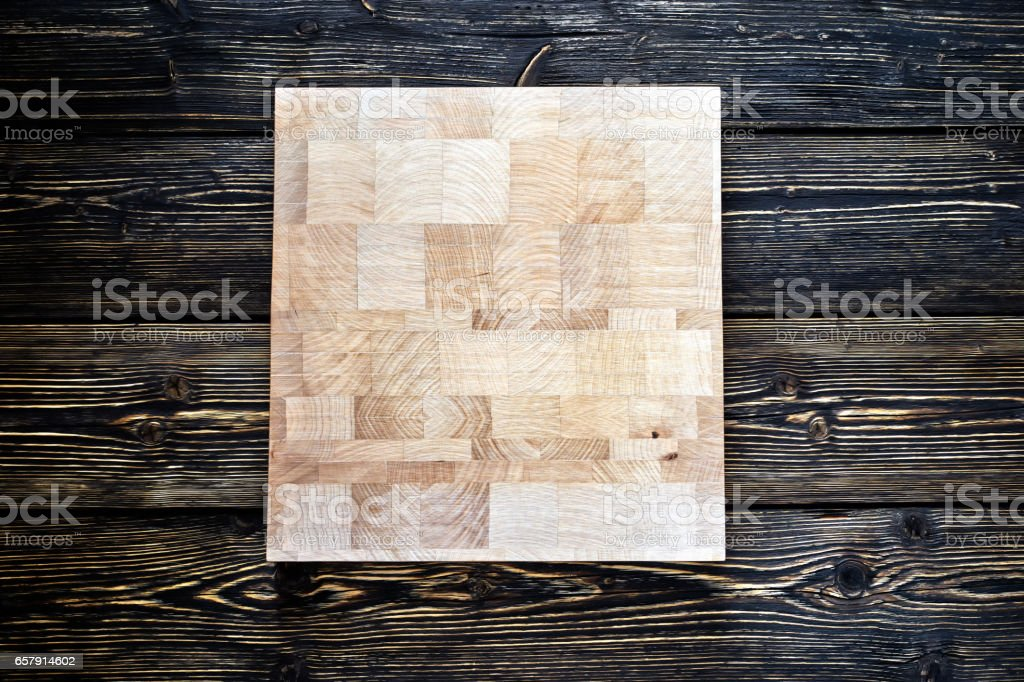 Chopping board on textured background stock photo