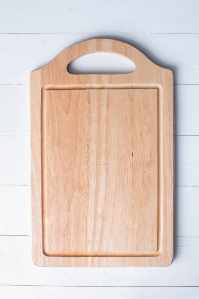 chopping board on white wooden background - разделочная доска стоковые фото и изображения