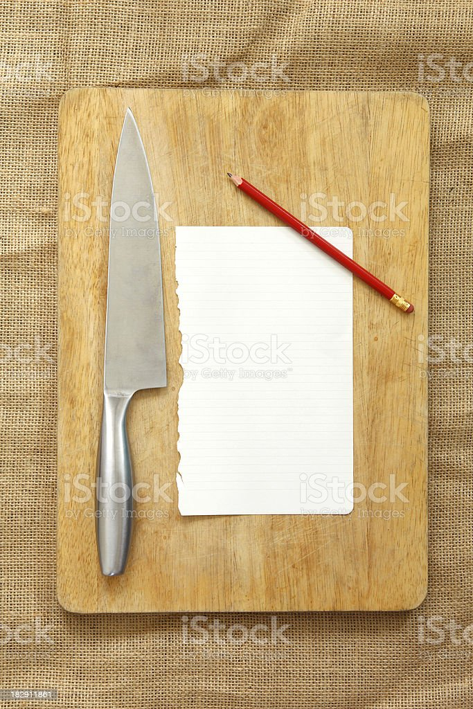 Chopping board with blank paper stock photo