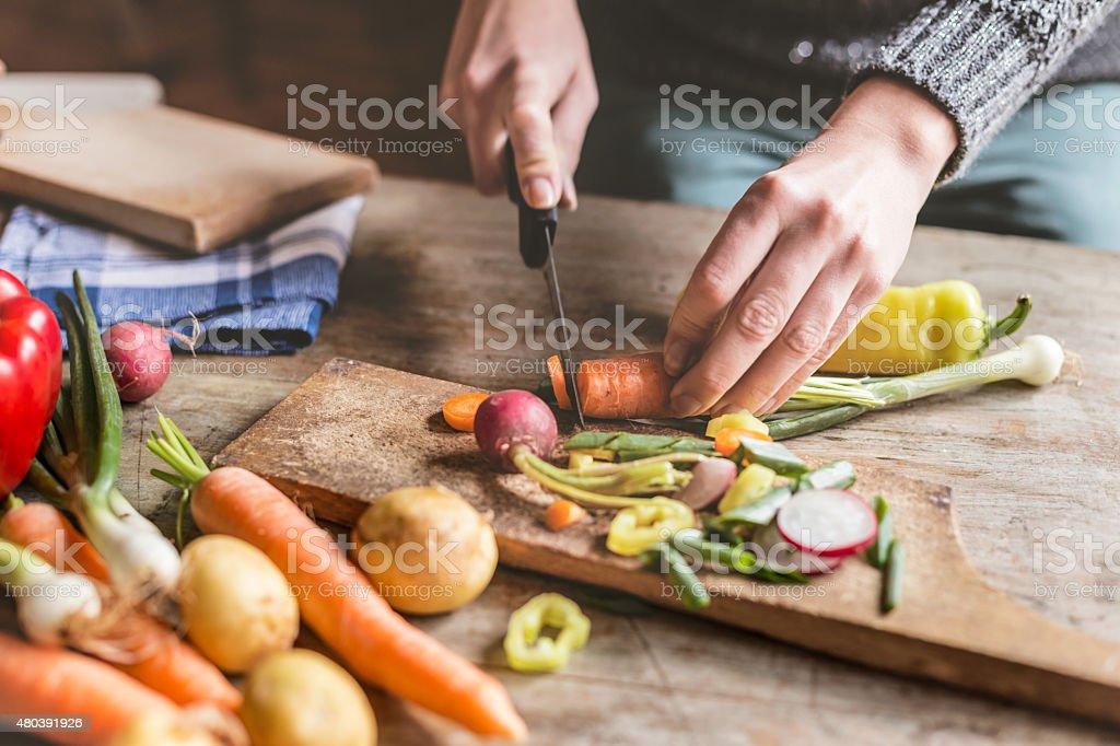 Chopping food ingredients Woman Chopping food ingredients 2015 Stock Photo