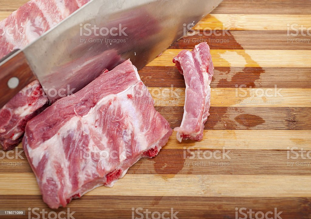 chopping fresh pork ribs royalty-free stock photo