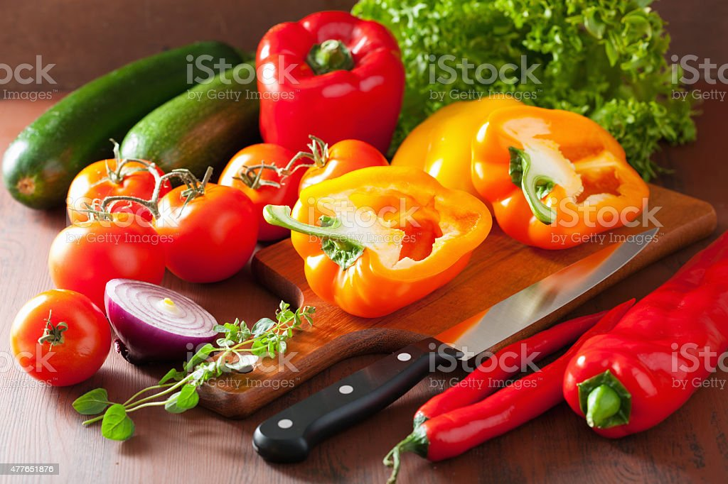 chopping healthy vegetables pepper tomato salad onion chili on r stock photo