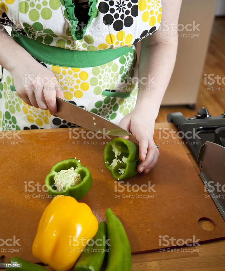 Chopping Peppers royalty-free stock photo