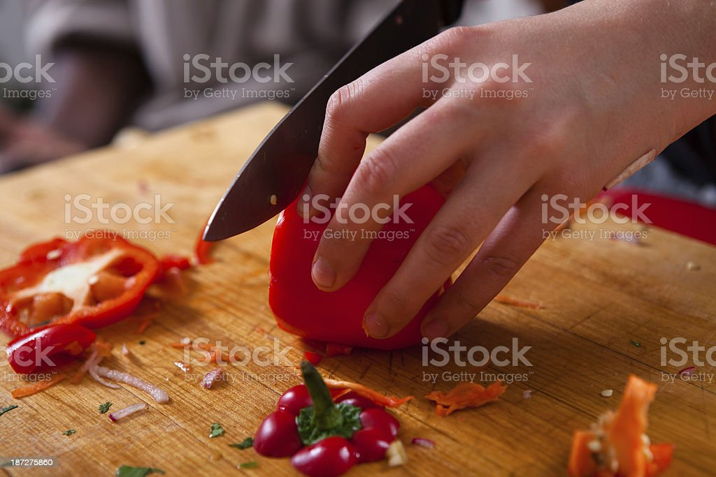 Chopping Red Bell Pepper stock photo