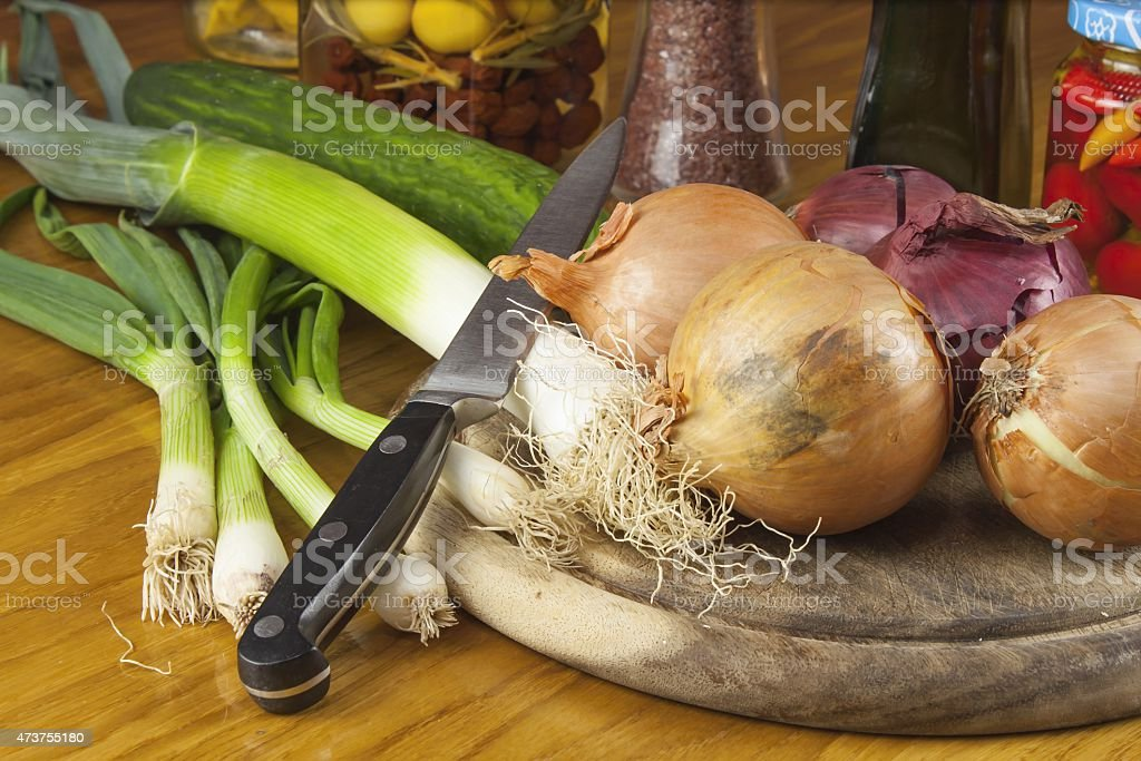 Chopping vegetables, preparing for grilling, Homework dietary meal stock photo