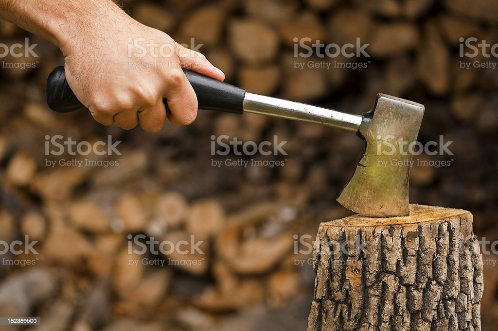 Chopping Wood with a Hatchet royalty-free stock photo