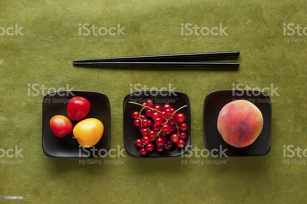 Chopstick Challenge – Asian Plums, Red Currants & Peach royalty-free stock photo