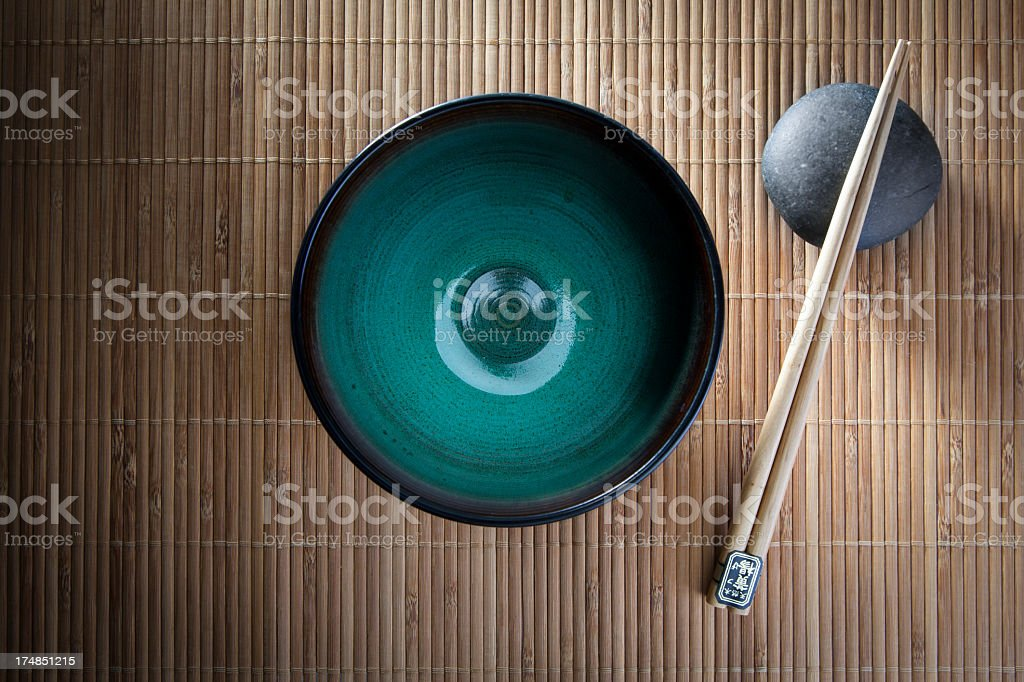 Chopsticks and bowl royalty-free stock photo