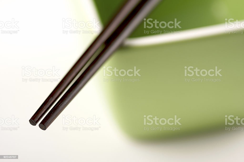 Chopsticks and Green Bowl royalty-free stock photo