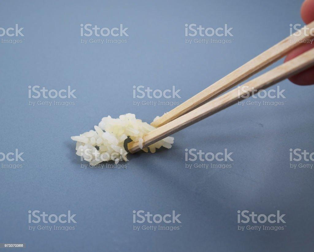 箸は米を保持 ストックフォト