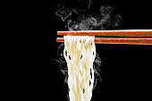 chopsticks noodles with smoke isolated on white background with clipping path
