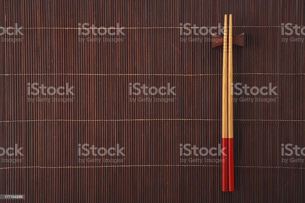 chopsticks on bamboo mat stock photo