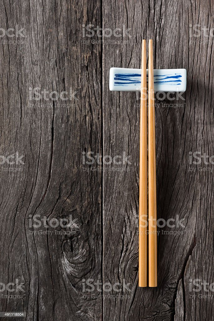chopsticks on chopsticks rest stock photo