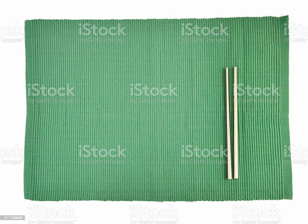 chopsticks on sushi mat stock photo