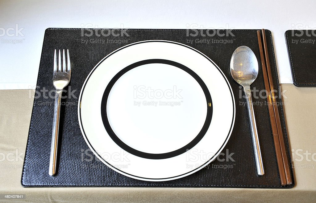 chopsticks plate and spoon royalty-free stock photo