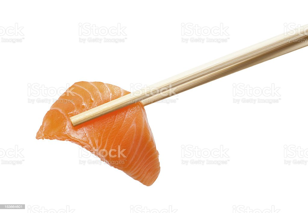Chopsticks with sliced raw salmon royalty-free stock photo