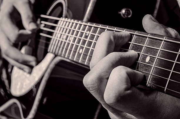chord detail of a chord of a musician playing an acoustic guitar country and western music stock pictures, royalty-free photos & images