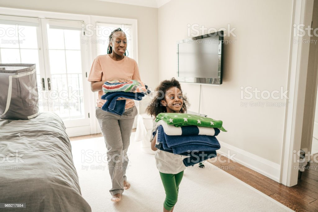 Chores that promote kids development royalty-free stock photo