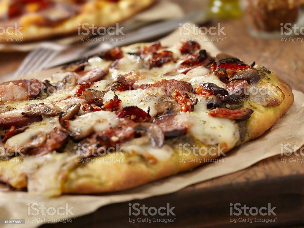 Chorizo and Pesto Pizza stock photo