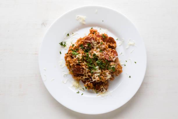 Chorizo risotto with tomato stock photo