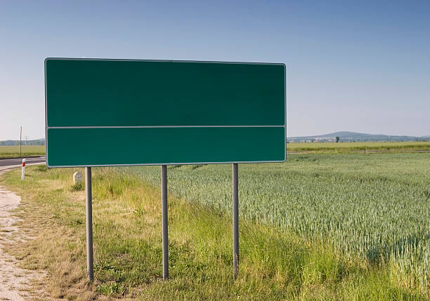Chose your way billboard in field near road READ FOR... stock photo