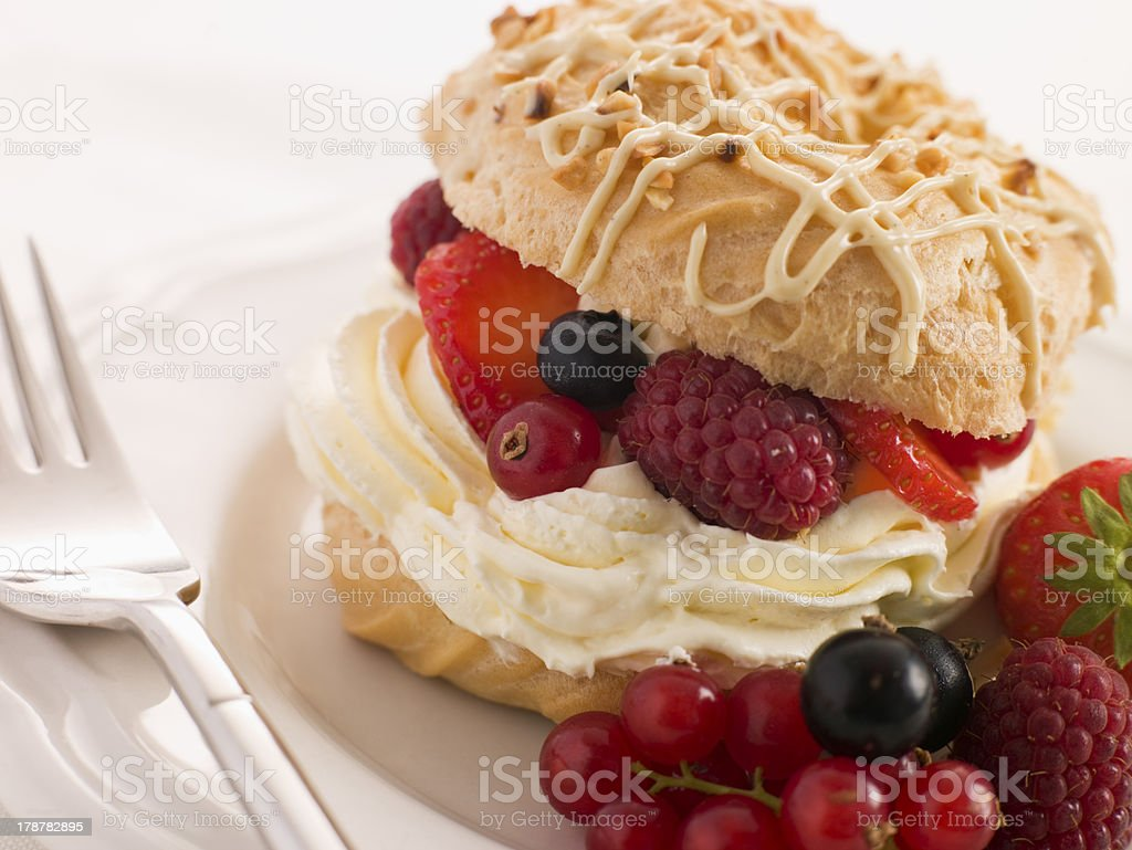 Choux Bun filled with Mixed Berries and Chantilly Cream royalty-free stock photo