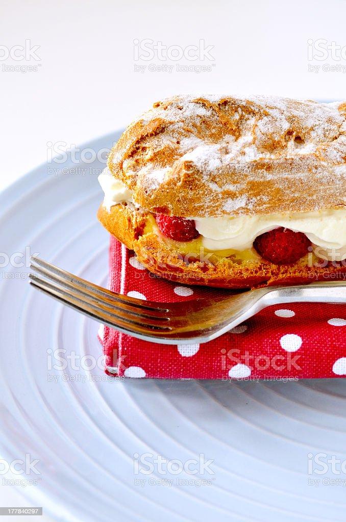 Choux pastry cream eclair slice royalty-free stock photo