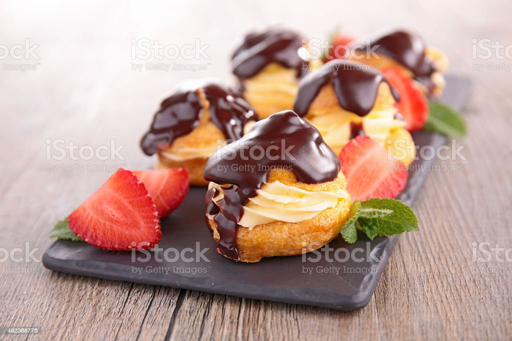 choux pastry with cream and chocolate stock photo