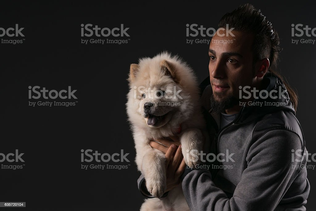 Chow Chow Puppy Dog And Young Boy Black Background Stock Photo