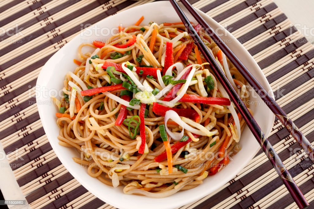 Chow mein in bowl stock photo