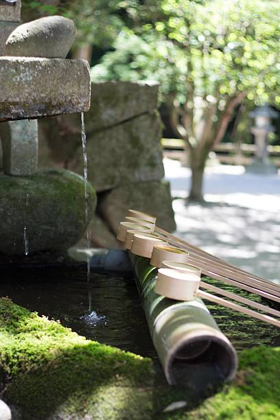 Chozuya at a Japanese Shinto shrine It is a Shinto water ablution pavilion for a ceremonial purification rite known as temizu. shinto shrine stock pictures, royalty-free photos & images