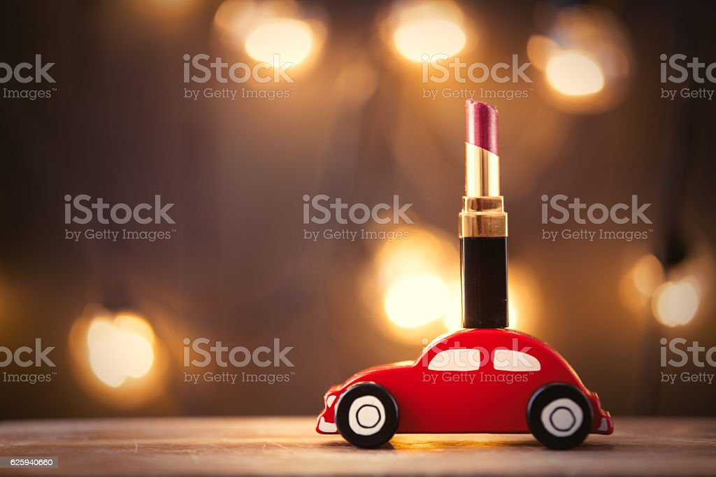 Chrismtas toy car and lipstick - foto de acervo