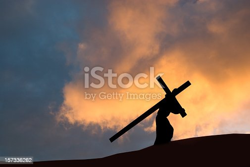 Christ carrying the Cross on Good Friday with a dramatic sky in the background.