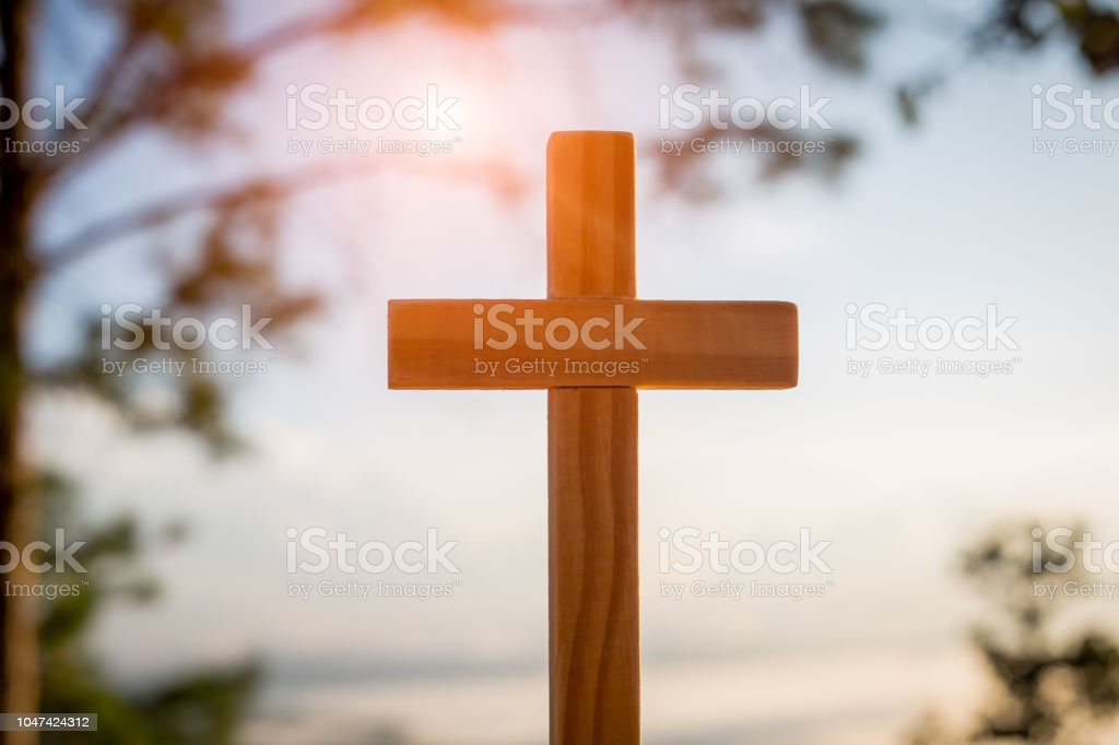 Christ Jesus cross in the sunrise colored sky background, Worship,...