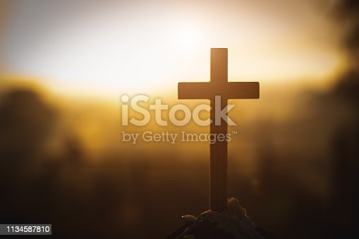 Christ Jesus  cross in the sunrise colored sky background, Worship,  Religious concept., Eucharist Therapy Bless God Helping Repent Catholic Easter Lent Mind Pray.