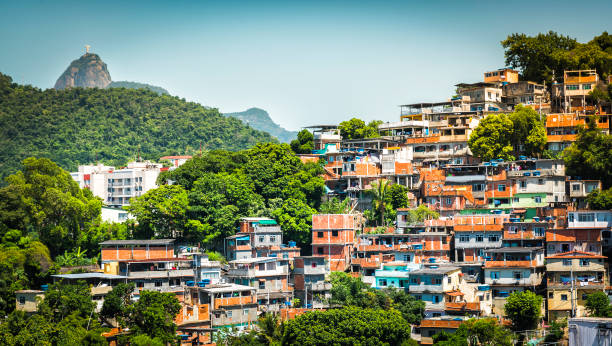 Christ looking at Favela (Shanty Town) in Rio De Janeiro stock photo