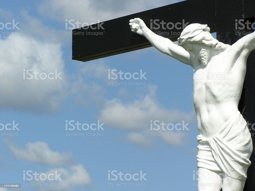 Christ on the Cross Under Cloudy Skies royalty-free stock photo