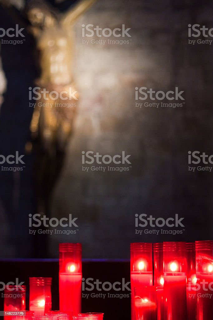 Christ statue and candles stock photo