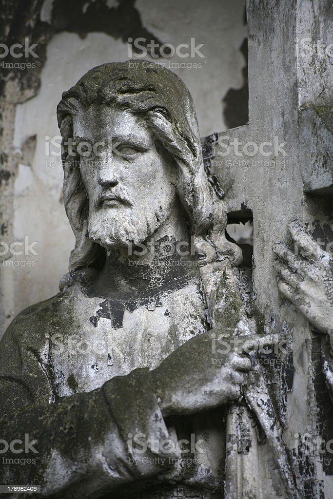 Christ statue in a cemetery stock photo