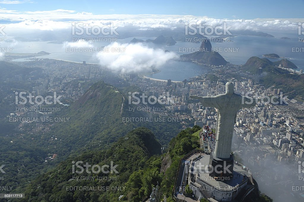 Christ the Redeemer watching over Rio de Janeiro stock photo